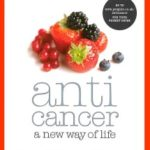 Photo of anti cancer a new way of life book with picture of fruit