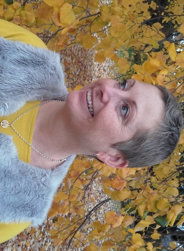 Photo of our client Vicky against an autumn background