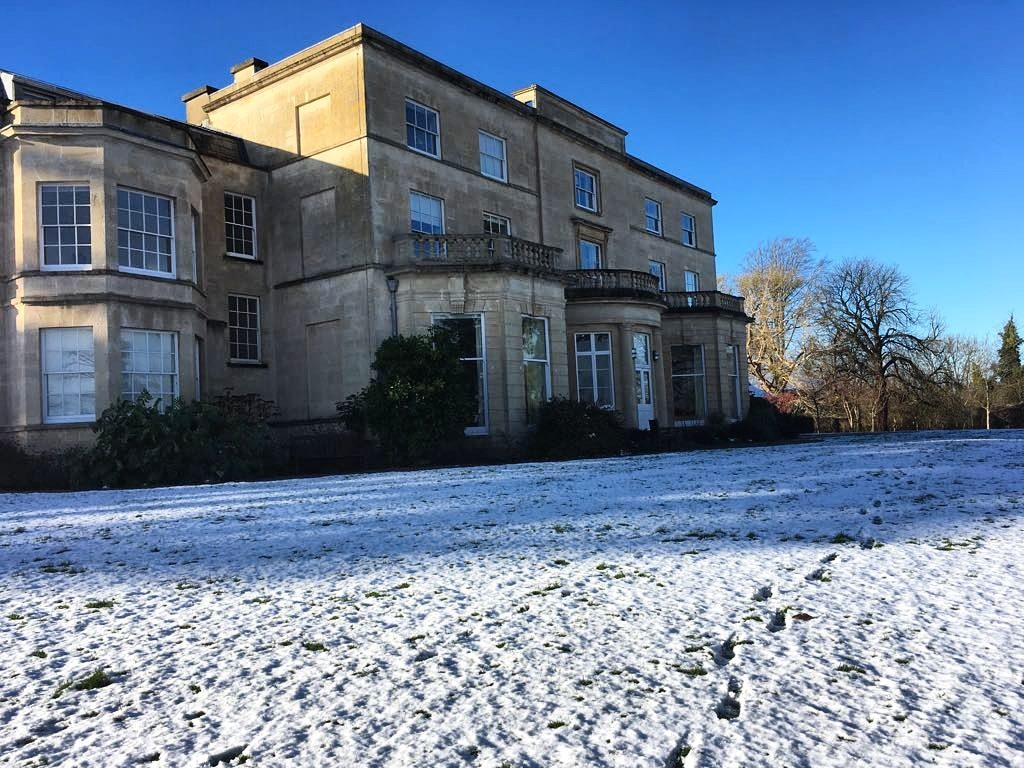 Snow on grass outside the Penny Brohn UK National Centre
