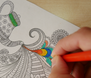 Person colouring in postcard