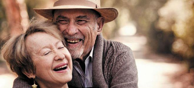 Photo of a couple laughing and hugging