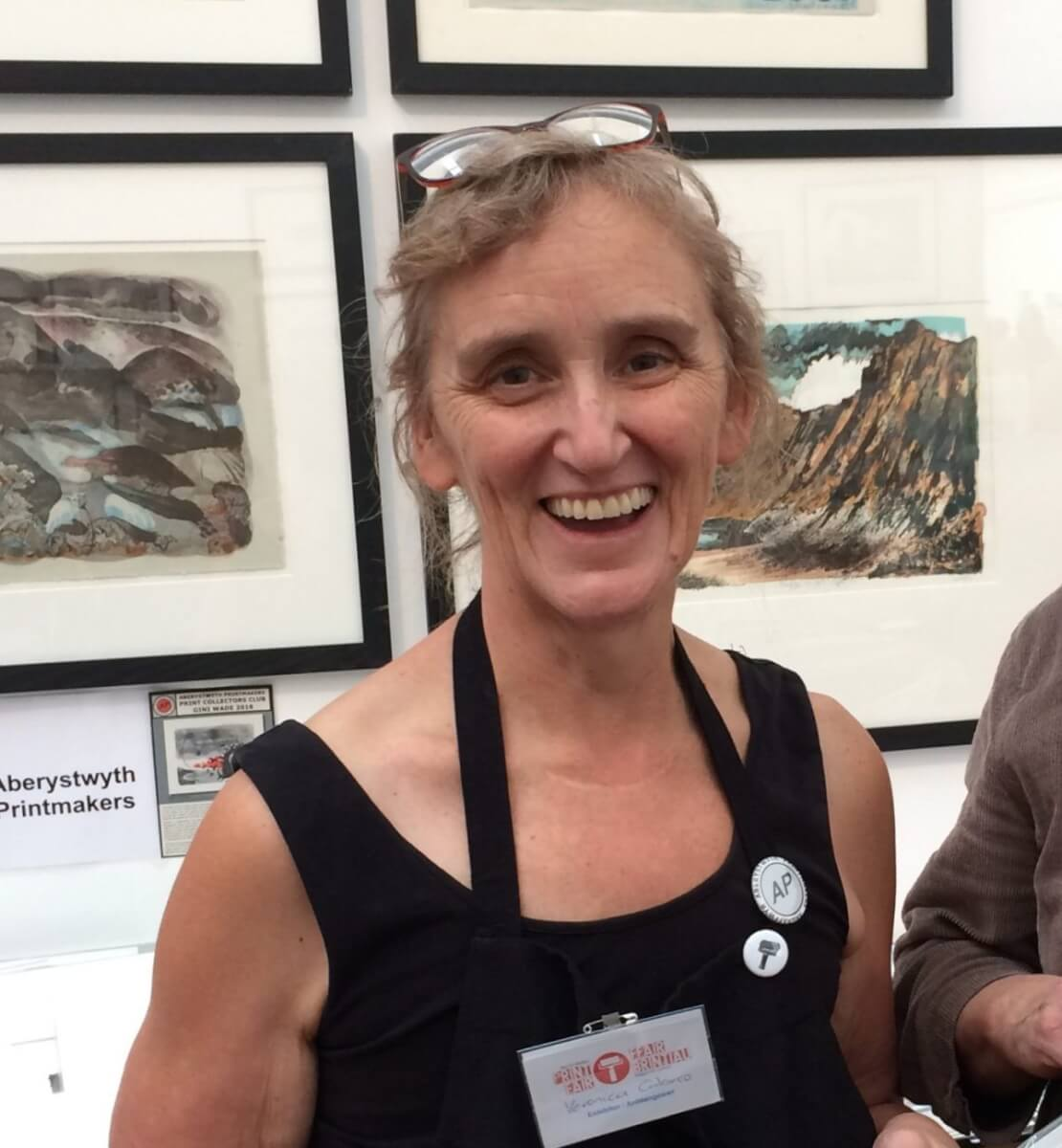 Photo of our client Veronica in an art gallery