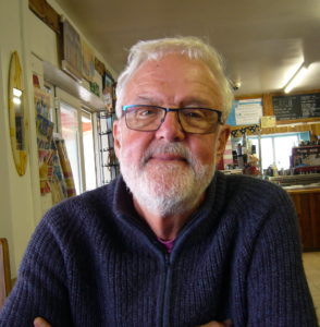 Photo of our client Stewart in a cafe