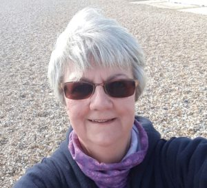 Photo of our client Susan on the beach