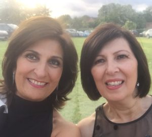 Photo of our client Filomena and sister Maria at a black tie event