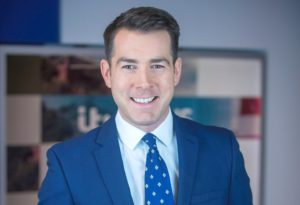 Picture of ITV News West Country Presenter, Jonty Messer wearing a suit