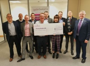 A photo of charitable networking group, What's Right presenting a giant cheque