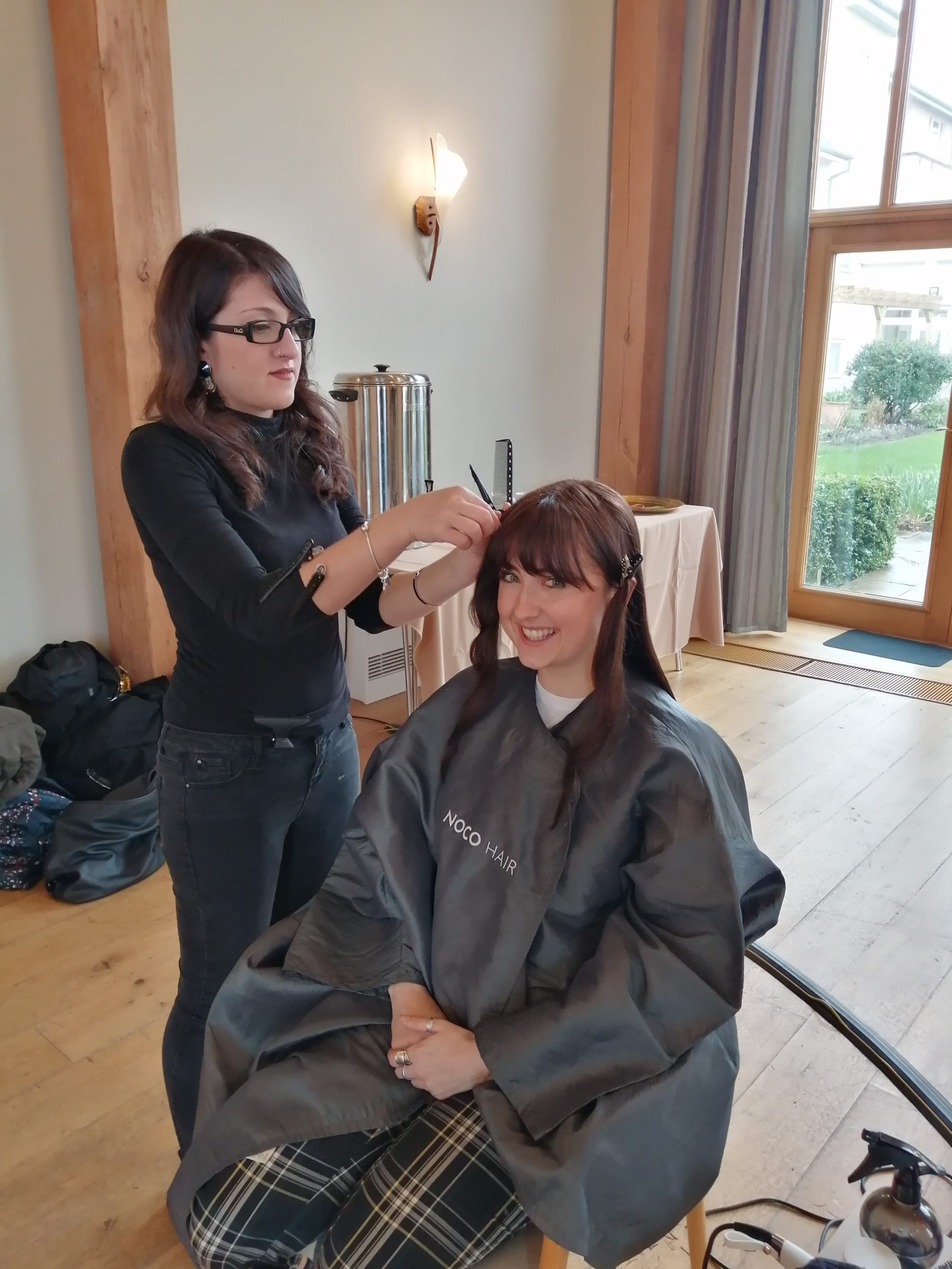 Photo of Sophie from fundrasing having her hair cut by Noco stylists